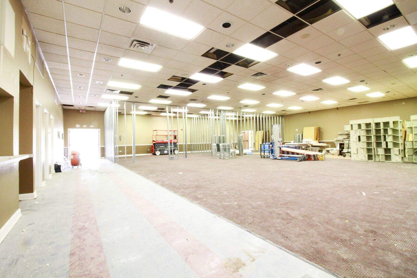 This room, which has passthrough access to the kitchen on the left, will serve as a multi-purpose event, meeting, and classroom space for mid-size events.